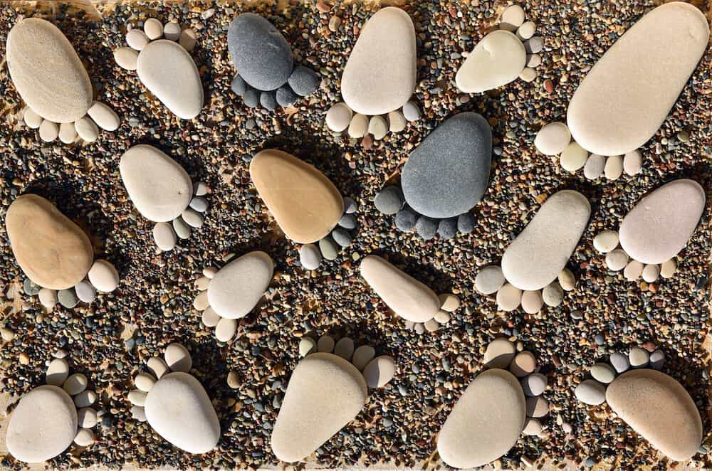 A photo of little feet made of pebbles to illustrate how the Nook Pebble Lite breathable crib mattress pebble cover allows airflow on the surface of the mattress