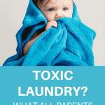 A Pinterest pin image featuring a photograph of a baby in a bath towel. There is text on the image that says Toxic Laundry? What All Parents Need to Know