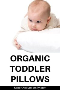 A pinterest pin featuring an image of a baby with a pillow on an isolated background. The text says Organic Toddler Pillows