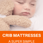 A Pinterest pin image featuring a photograph of a baby sleeping in a crib with a teddy bear. There is text on the image that says Crib Mattresses: A Super Simple Buyer's Guide.