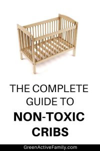 "A pinterest pin with the text ""the complate guide to non-toxic cribs"" with an image of a wood crib"