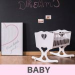 A pinterest pin with an image of a baby girl nursery with cradle. The text says baby rocking cradles.