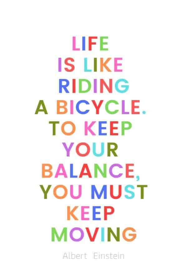 A pinterest pin with an albert einstein quote for kids written in colorful text on a white background. The text reads, Life is like riding a bicycle. To keep your balance, you must keep moving.