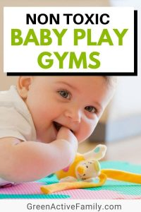 A pinterest image showing a baby lying on his tummy on the floor. The text says Non Toxic Baby Play Gyms