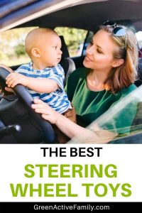 A Pinterest pin to accompany an article about the best steering wheel toys for toddler. The image shows a baby standing on his mother's lap to pretend driving in a car. The text says The best Steering Wheel Toys