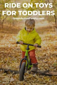 A pinterest pin with a picture of a young boy on a foot bike. The text says Ride On Toys for Toddlers