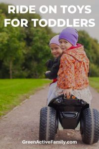 A pinterest pin with a picture of 2 young girls driving a car for kids. The text says Ride On Toys for Toddlers