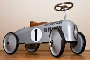 A ride on toy for toddler that looks like an old time race car