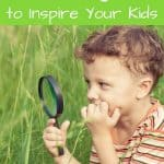 A pinterest pin with an image of a young boy with a magnifying glass in a grassy field. The text says 22 Awesome Einstein Quotes to Inspire Your Kids