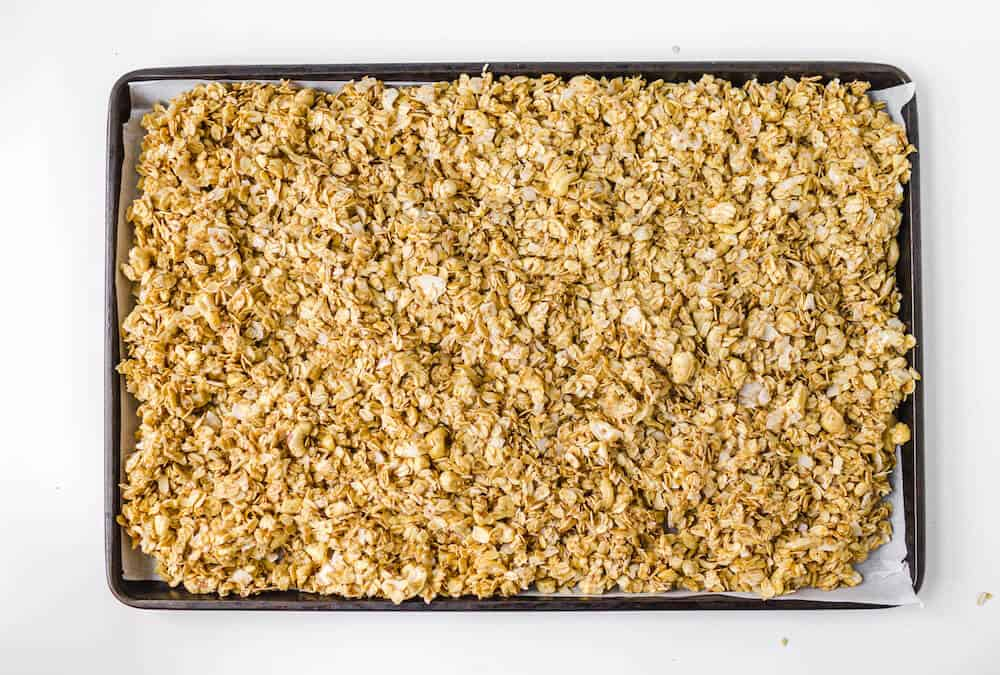 Ingredients for cashew coconut granola spread out on a baking sheet