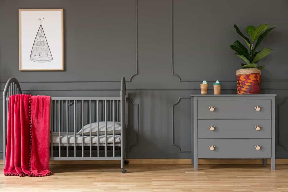 Fancy Gray Baby Crib in a nursery