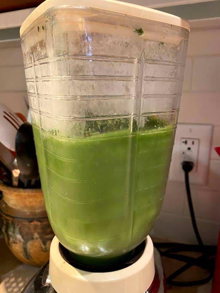 Revive Superfoods Grass is Greener smoothie being blended in a vintage blender.