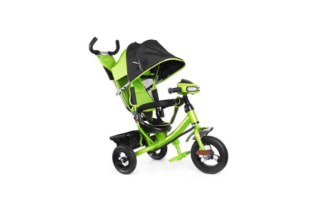 A green tricycle with push handle against an isolated white background