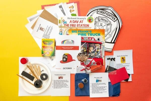 A photograph showing different activities included in the Get Ready 4 Kindergarten subscription box. The box shows fire station themed activities