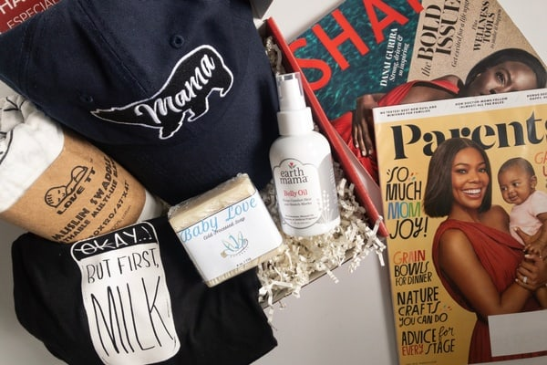 An photographs of products contained in the Lena Rose New Mom Subscription box, including  a magazine, personal care items, and accessories