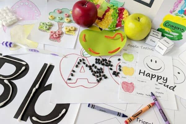 A photo showing the contents of Little Minds Learning box, including phonics and reading activites, math and sorting activities, and motor skills lacing activities