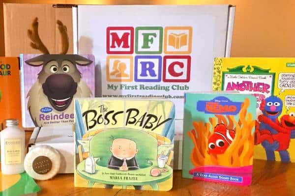 A photograph showing a My First Reading Club subscription box on a table with different kids books contained within.